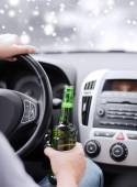 Close up of man drinking alcohol while driving car — Stock Photo