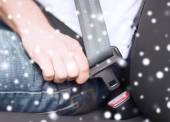 Close up of man fastening seat belt in car — Stockfoto
