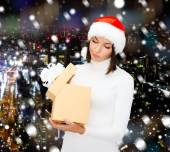 Woman in santa helper hat with gift box — Stock Photo