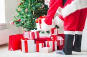 Close up of santa claus with presents — ストック写真