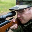 Close up of soldier or hunter with gun in forest — Stock Photo #55991979