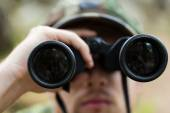 Close up of soldier or hunter with binocular — Stock Photo