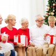 Smiling family with gifts at home — Stock Photo #56068559