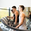 Group of men exercising on treadmill in gym — Stock Photo #56068765