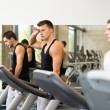 Group of men exercising on treadmill in gym — Stock Photo #56068779