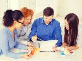 Team with color samples and blueprint at office — Stock Photo