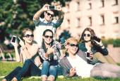 Students showing smartphones — Stock Photo