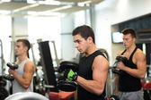 Group of men with dumbbells in gym — Stockfoto