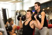 Group of men with dumbbells in gym — Stock Photo
