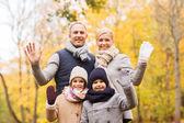 Happy family in autumn park — Stock Photo