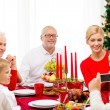 Smiling family having holiday dinner at home — Stock Photo #56118855