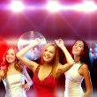 Three smiling women dancing in the club — Stock Photo #56178295