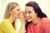 One girl telling another secret — Stock Photo