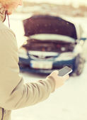 Closeup of man with broken car and cell phone — Stock Photo