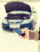 Closeup of man with broken car and cell tphone — Stock Photo