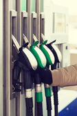 Close up of male hand holding fuel pump — Stock Photo