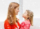 Happy mother and daughter kissing — Stock Photo