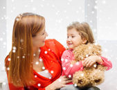Mother and daughter with teddy bear toy — Stock Photo