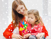 Mother and daughter with pinwheel — Stock Photo