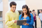Group of smiling students tablet pc computer — Stock Photo