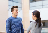 Group of smiling students outdoors — Stock Photo