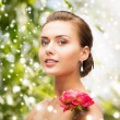 Woman with diamond earrings, ring and flower — Stock Photo #56576109