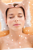 Beautiful woman getting face or head massage — Stock Photo