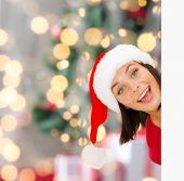 Woman in santa helper hat with blank white board — Stock Photo