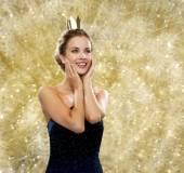 Smiling woman in evening dress wearing crown — Foto Stock