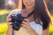 Close up of young girl with photo camera outdoors — Stock Photo