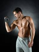 Young man with dumbbell — Stock Photo