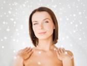 Beautiful woman touching her shoulders — Stock Photo