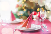 Room with christmas tree and decorated table — Stock Photo