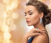 Beautiful woman wearing ring and earrings — Stock Photo