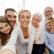 Happy family making selfie at home — Stock Photo #56672273