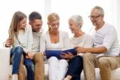 Happy family with book or photo album at home — Stock Photo
