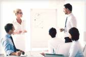 Business team working with flip chart in office — Stock Photo