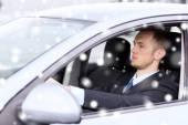 Close up of businessman driving car — Foto Stock