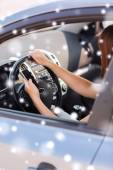 Close up of woman with  smartphone driving car — 图库照片