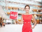 Smiling woman in santa helper hat with sale sign — Stock Photo