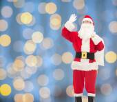 Man in costume of santa claus with bag — Photo