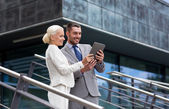 Smiling businessmen with tablet pc outdoors — Stock Photo