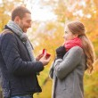 Smiling couple with engagement ring in gift box — 图库照片 #56760569