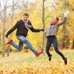 Smiling couple having fun in autumn park — Stock Photo #56760695