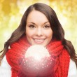 Smiling woman in winter clothes with snowball — Stock Photo #56936203