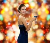 Smiling woman holding cocktail — Foto de Stock