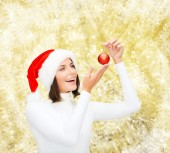 Woman in santa helper hat with christmas ball — Stock Photo
