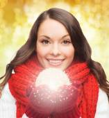Smiling woman in winter clothes with snowball — Foto de Stock