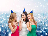 Smiling women holding glasses of sparkling wine — Stock Photo