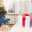 Gift box on coach at home — Stock Photo #56941393